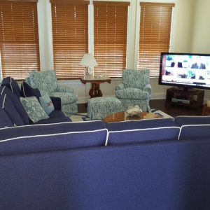 blue sectional in front of tv
