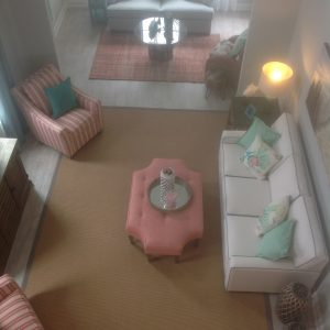 Aerial view of pink and white living room