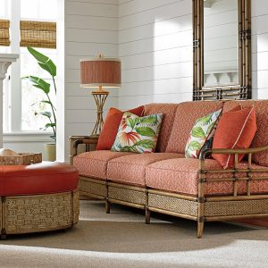 bamboo chair and ottoman with orange cushion