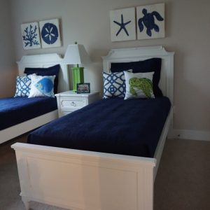 two white beds with blue mattress
