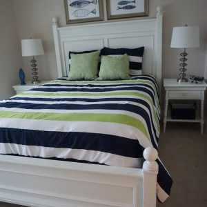 white bed with night stands and lamp