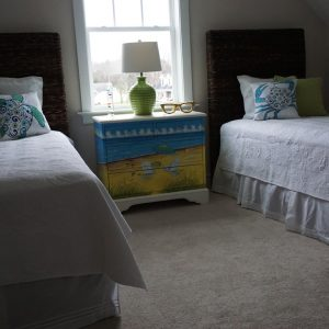 two twin beds with white sheets