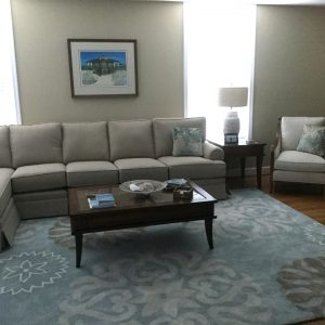 sectional and a sofa chair with coffee table