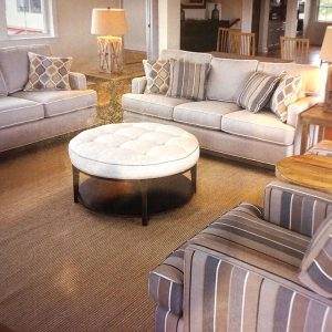 tan brown sofas and a round table