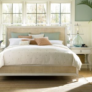 white bed with glass lamps on night stands