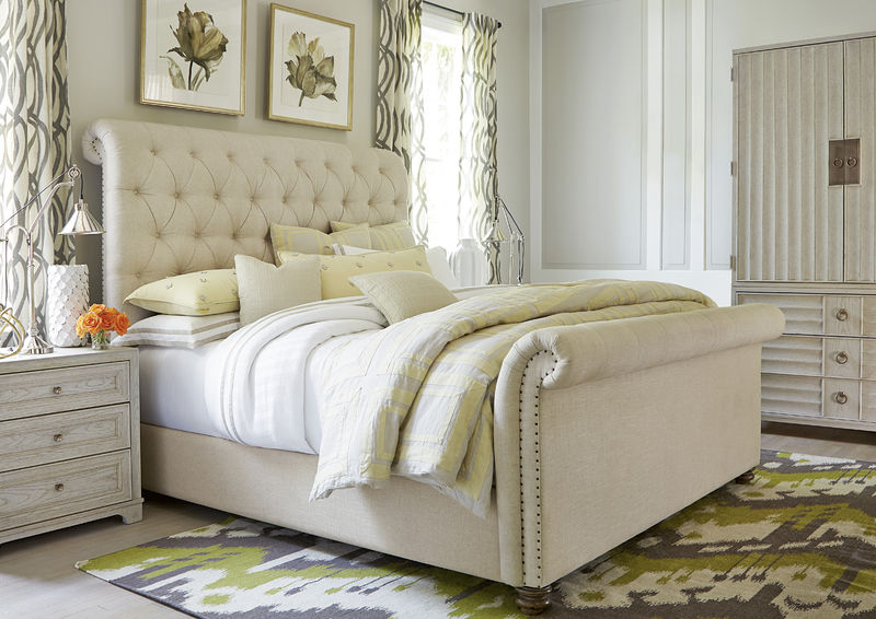 white bed with dresser and night stand