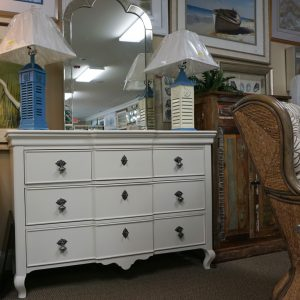 dresser with two blue lamps