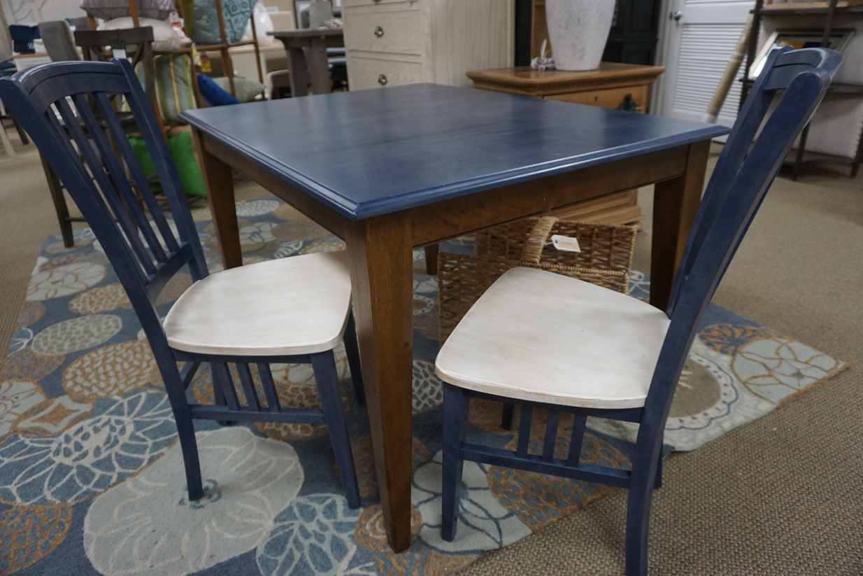 blue table with two chairs