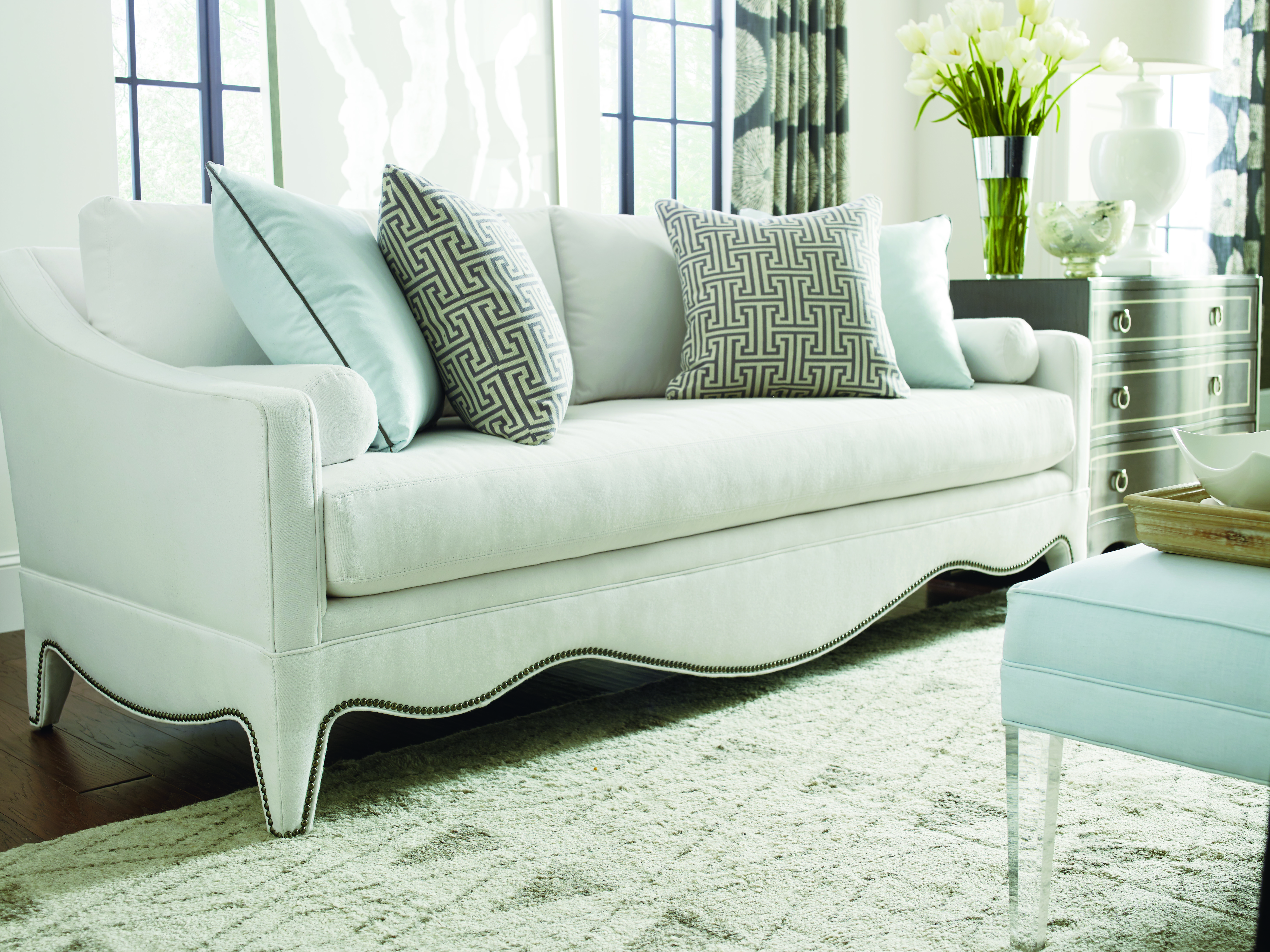 white sofa with cushions